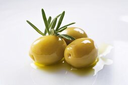Green olives with olive oil and rosemary