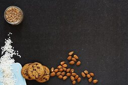 Still life with almonds, chocolate chip cookies, short-grain rice and cereal