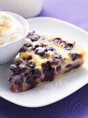 Piece of blueberry tart with cream