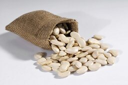 White beans spilling out of hessian sack