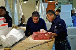 Workers packing tuna at Tsukiji Fish Market in Tokyo