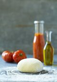Pizza dough, tomatoes, ketchup and olive oil