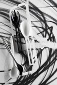 Black and white salad servers and kitchen spoons