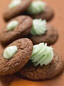 Chocolate macaroons with green cream