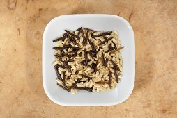 Brown rice and wild rice in dish from above