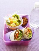 Tuna wraps and fruit salad in lunch box