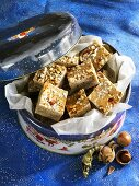 Gingerbread with chopped hazelnuts in biscuit tin