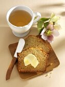 East Frisian honey cake with butter, cup of tea