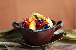 Fried Japanese persimmons with aubergine and peppers (sweet and sour)