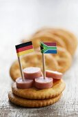 Crackers with sausage slices and flags