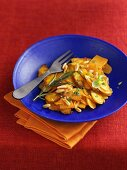 Pan-cooked pumpkin and carrots with herbs and pine nuts
