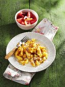 Kaiserschmarrn (shredded pancakes) with apple compote