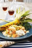 Sea food pie with a grilled corn cob
