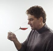 Sniffing a glass of wine: checking bouquet and aroma