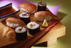 A plate of sushi: nigiri, maki, ginger, wasabi and soya sauce