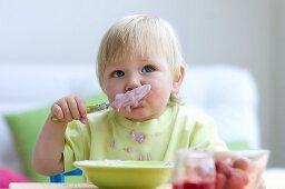 Toddler eating baby food