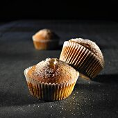 Sugared muffins in paper cases