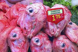 Lamb heads on a market stall (Mercat de St. Josep (Boqueria), Las Ramblas, Barcelona, Spain)