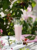 Raspberry milkshake with daisies