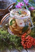 Sweet and sour pickled ceps in preserving jar