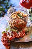 Mushroom sauce in jar with sea buckthorn berries