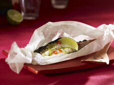 Monkfish tails in baking parchment