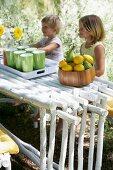 Children sitting at set table in garden