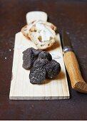 Black truffles on a wooden board