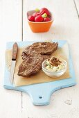 Fried rump steak and garlic butter with anchovies