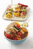 Barbecued vegetable skewers with pita bread