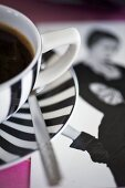 Coffee in striped cup and saucer