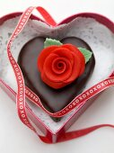 Chocolate heart with marzipan rose to give as a gift