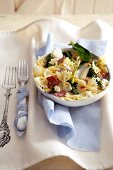 Farfalle with spinach, feta cheese and bacon