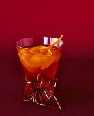 Mandarin orange punch in glass with bow