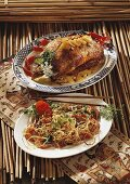 Two Asian dishes: roast duck and fried noodles