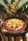 Three-coloured star-shaped coconut cake