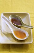 Fish sauce and oyster sauce in Asian soup spoons