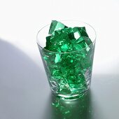 Green jelly cubes in a glass