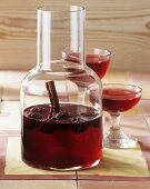 Home-made blackberry liqueur in carafe and glasses