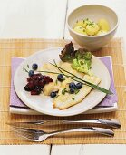 Fried plaice fillets with berry compote