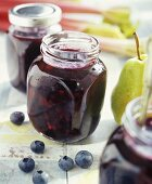 Blueberry and pear jam in jam jars