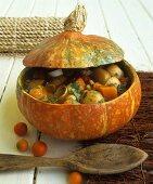 Hearty pumpkin stew in hollowed-out pumpkin