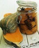 A fresh squash beside pickled squash in preserving jar
