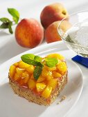 Cocoa sponge heart topped with peaches