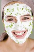 Woman with quark and cress face mask