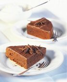 Two pieces of chocolate cake
