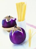 Round aubergines and spaghetti