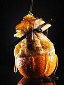 Honey running over crepe in orange half