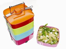 Lunch box and couscous salad with grapes and feta