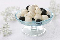 Mozzarella balls with black olives